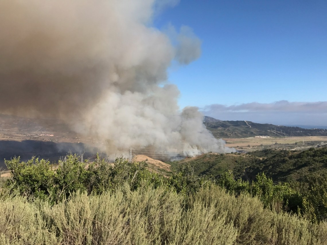 A wildland fire grew to 400 acres by 8:20 p.m. on Wednesday, June 28, on the north end of Camp Pendleton, just south of San Clemente. Firefighters will monitor the blaze throughout the night, and no evacuations have been ordered, according to OCFA. Photo: Jake Howard
