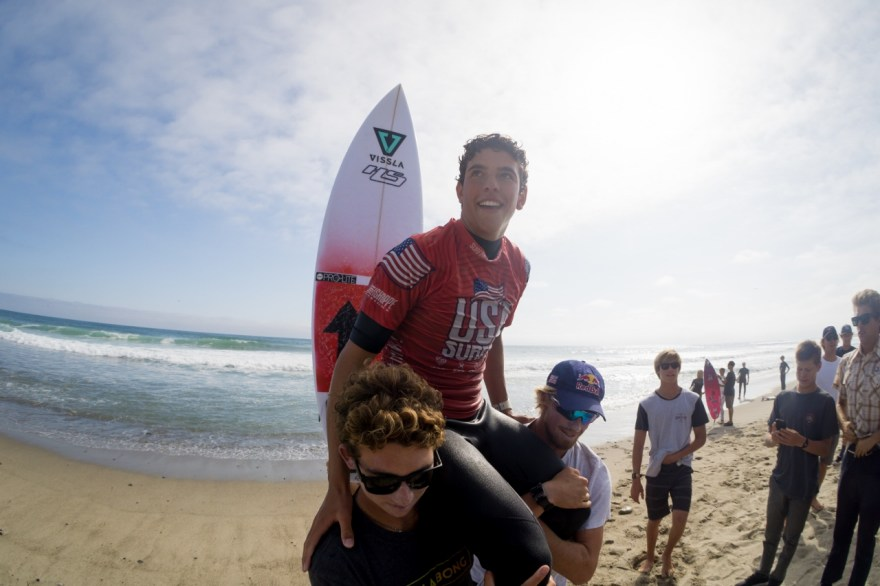 Crosby Colapinto is lifted by surfers after winning