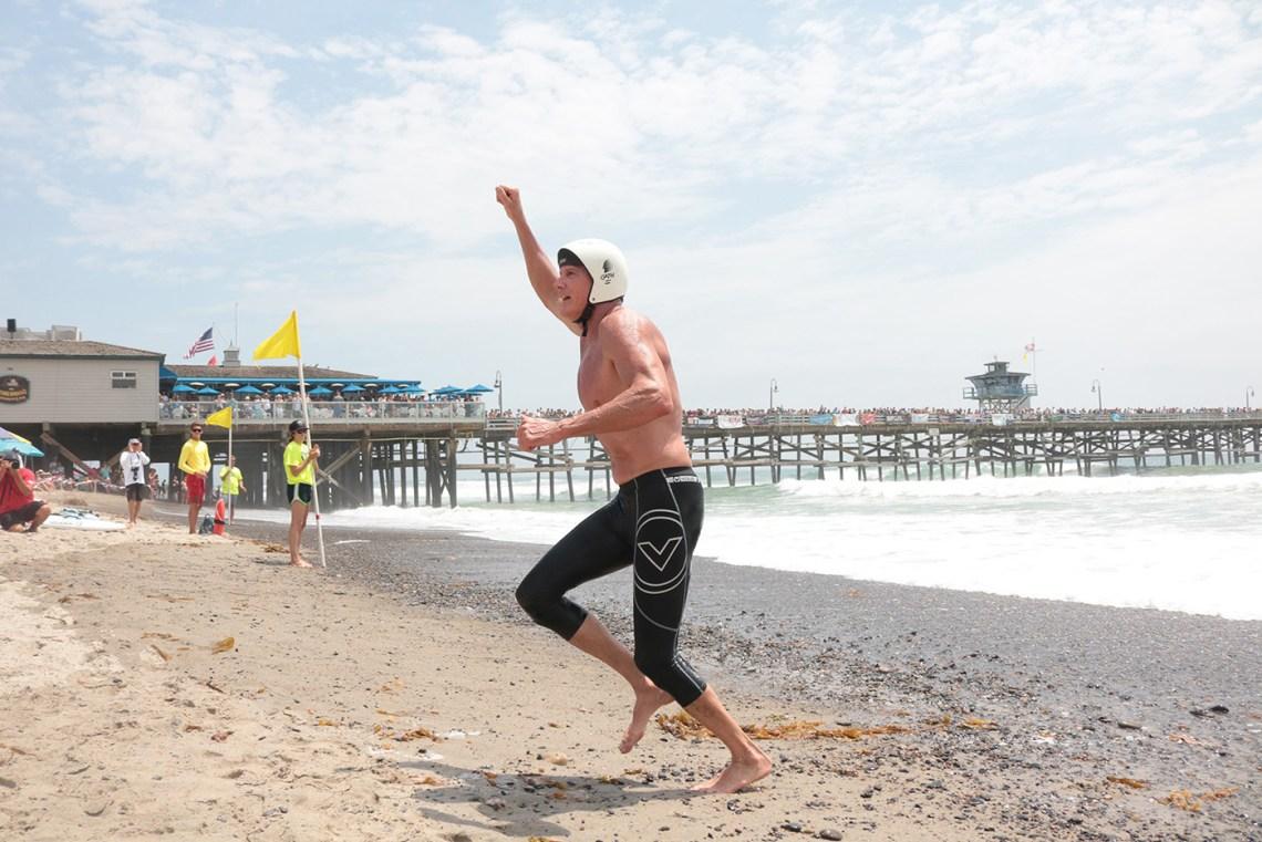 San Clemente's Mitch Kahn celebrates winning the American Ironman race. Photo: Eric Heinz