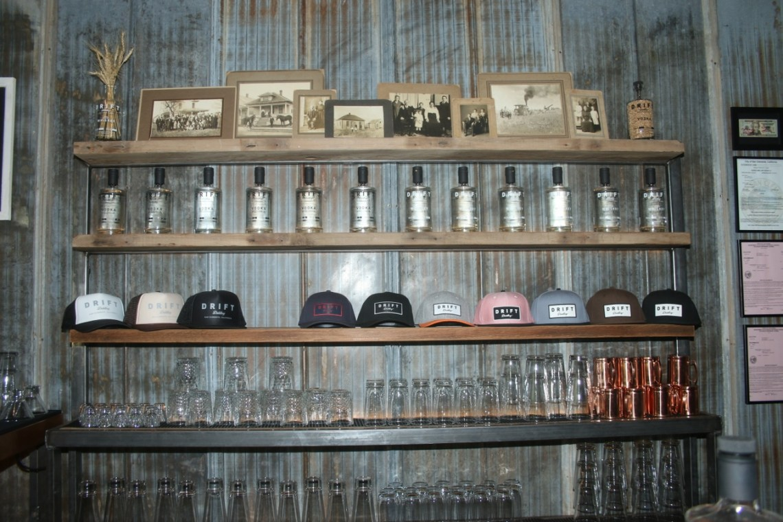 The shelves of whiskey and vodka are filled up at Drift Distillery in San Clemente. Photo: Eric Heinz