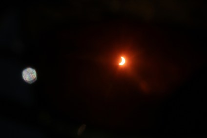 About 60 percent of the sun's light was blocked by the moon's path to create a partial solar eclipse in Orange County on Monday morning, Aug. 21. A total solar eclipse was seen throughout the United States. Photo: Eric Heinz