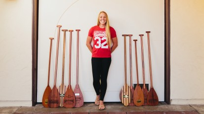 Candice Appleby poses with some of her stand-up paddleboard trophies. The SUP legend, and San Clemente native, has won over 90 professional events. Photo: Matthew Morgan