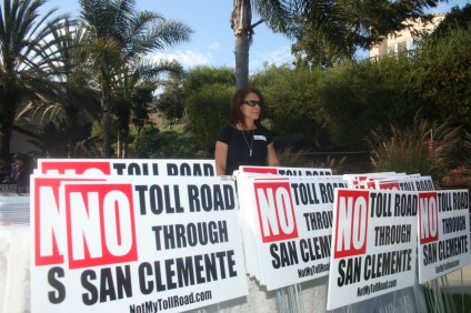 Pam Tucci stands at the entrance of a sports park in The Reserve subdivision in San Clemente to help raise funds for the Coalition to Save San Clemente on Sept. 9. Photo: Eric Heinz