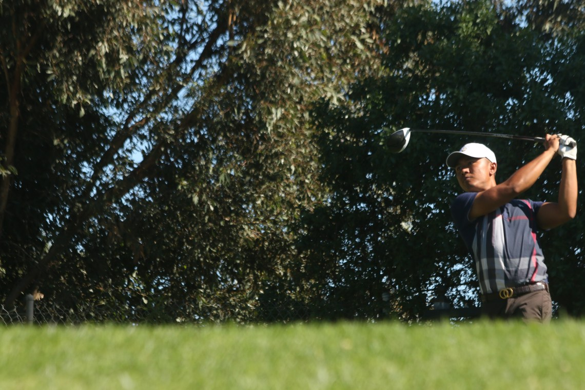 Marc Reyes tees off on the par-4 14th hole during the final round of the San Clemente City Golf Amateur Championship. Photo: Eric Heinz