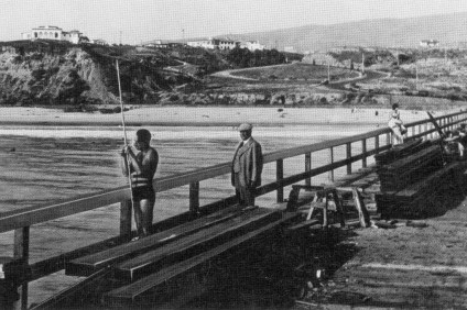 The San Clemente Pier was constructed in 1928, and next year locals will celebrate its 90th birthday. In this photo, planks are applied toward the end of the Pier, as Ole Hanson's house sits in the background.  Photo: Courtesy of Orange County Archives