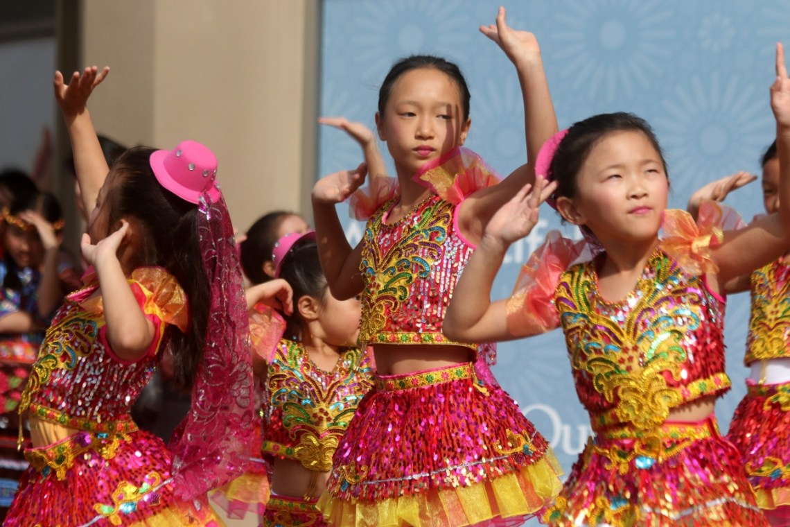 Performers with Irvine Chinese School & Cultural Center entertained people during the third annual Chinese Lunar New Year celebration at the Outlets at San Clemente. Photo: Eric Heinz