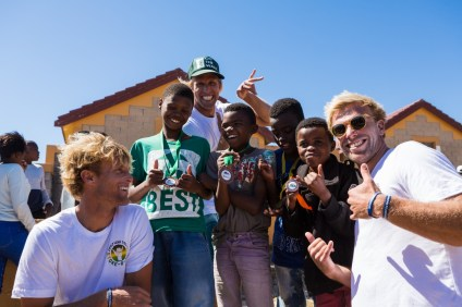 Dane, Pat and Tanner Gudauskas enjoying the South African Stoke-O-Rama awards celebration with a few of their new Cape Town friends from the Waves For Change organization. Photo: Vans/Daniel Grebe