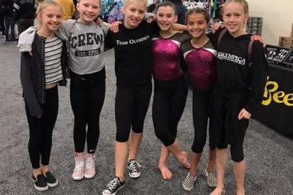 Some of Olympica's Level 7 gymnasts enjoy their success at the State Championships: Parsons, Richards, Proctor, Driessen, Julia Rojas of San Clemente and Thrall. Photo: Courtesy Stacy Richards