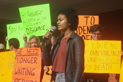 Esther Mafouta, a sophomore SCHS student, speaks to an audience of her peers during a walkout demanding gun law reform on March 14. Photo: Eric Heinz