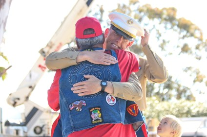 Capt. Cole Lapierre, the company commander at the headquarters of the 5th Marine Regiment, gives a hug to a Vietnam War veteran during a ceremony dedicating a monument to the veterans on March 29 at Camp Pendleton.
