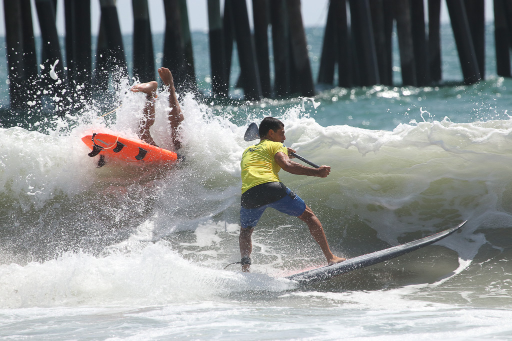 Choppy surf on Saturday afternoon, July 21, made the stand-up paddle surf heats difficult, but competitors weathered the elements regardless. Photo: Eric Heinz