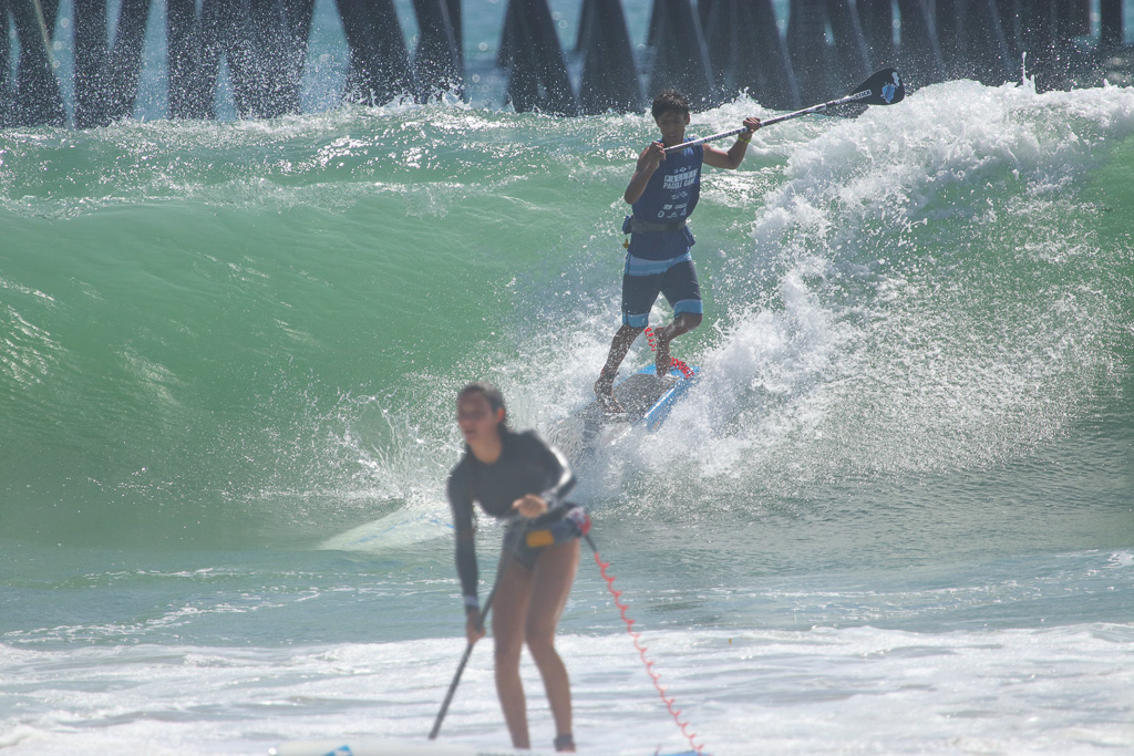 Waves 3- to 5-feet in size or larger put an extra spin on the stand-up paddleboard races at Ocean Festival on Sunday, July 22. Photo: Eric Heinz
