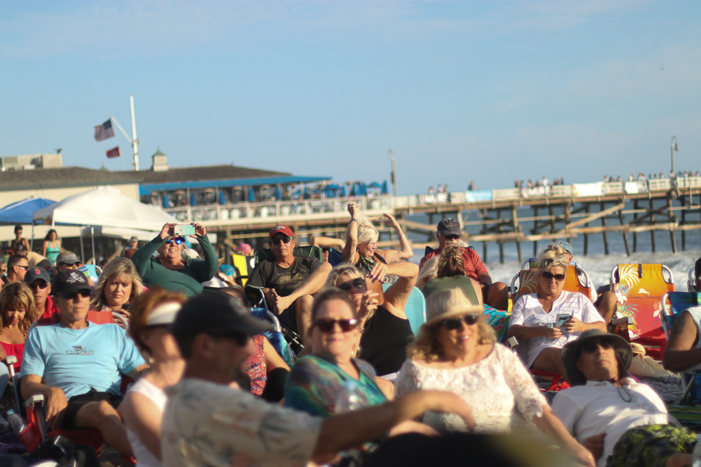 Hundreds of people stuck around for the beach concert at the San Clemente Ocean Festival on Saturday, July 21. Photo: Eric Heinz