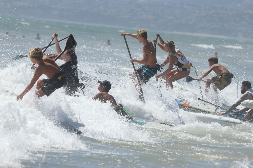 Waves 3- to 5-feet in size or larger put an extra spin on the stand-up paddle board races at Ocean Festival on Sunday, July 22. Photo: Eric Heinz