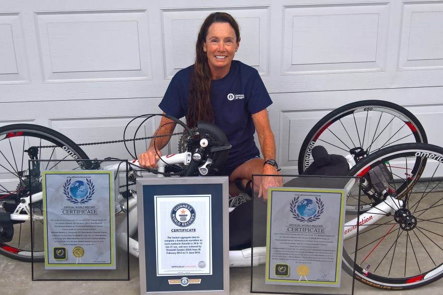 San Clemente resident Beth Sanden with her handcycle and three world records for completing handcycle marathons on all seven continents and the North Pole. Photo: Courtesy