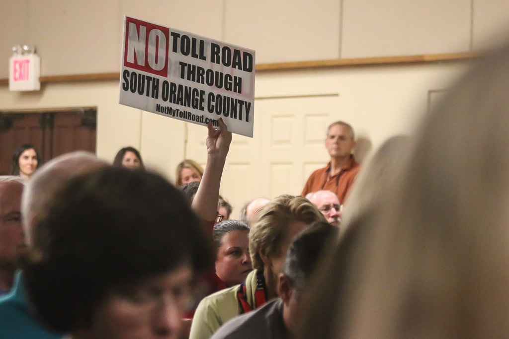 """No Toll Road Through San Clemente"" or ""South Orange County"" signs were prevalent at the Toll Road Town Hall hosted by the city of San Clemente on Oct. 24. Photo: Eric Heinz"