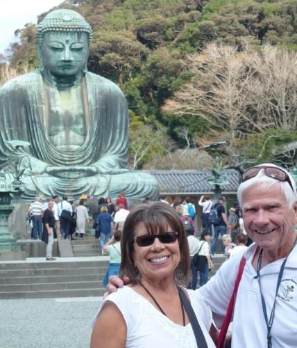 Tom Blake, right, with his partner, Greta, at The Great Buddha in Kamakura, Japan. Photo: Courtesy of Tom Blake