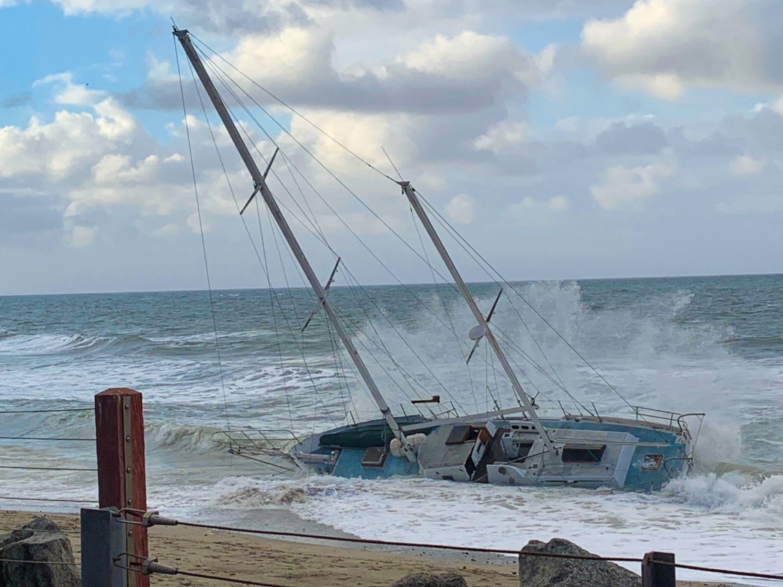 A sailboat washed ashore early Tuesday morning, Dec. 25 at North Beach near Capistrano Shores subdivision. No injuries have been reported thus far. Photo: Fred Swegles