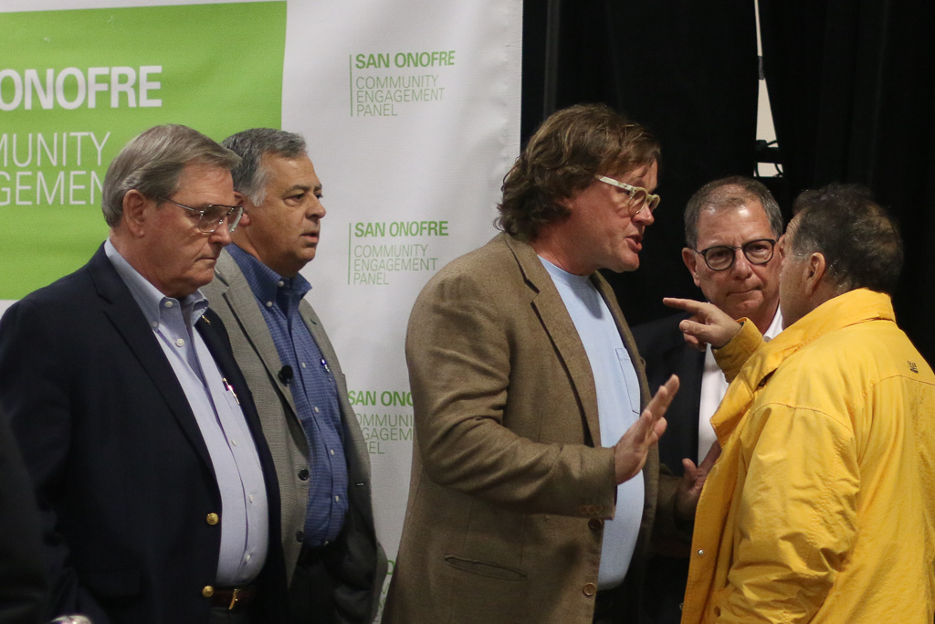 """David Victor, Ph.D., center, tells a man to """"back off"""" prior to the beginning of the CEP meeting on Nov. 29 in Oceanside. The man was escorted away from Victor but allowed to remain at the meeting. Photo: Eric Heinz"""