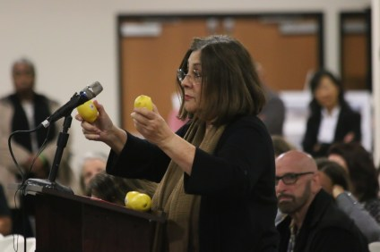 Donna Gilmore of the website San Onofre Safety holds up a pair of lemons, a symbol of her frustration with the operators of SONGS. Public speakers were outraged during the Community Engagement Panel meeting on Nov. 29 in Oceanside, where officials from Southern California Edison and the Nuclear Regulatory Commission explain the next steps in the enforcement process regarding an incident with a spent nuclear fuel canister in August. Photo: Eric Heinz