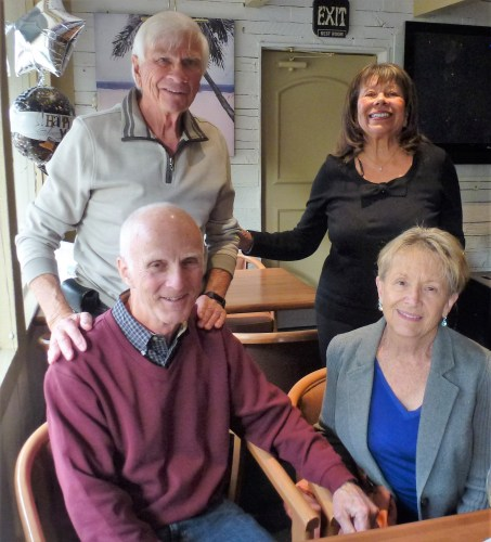Tom Blake and his partner, Greta, stand behind Mark Flannery, left, and Donna Harwood. Photo: Courtesy of Tom Blake