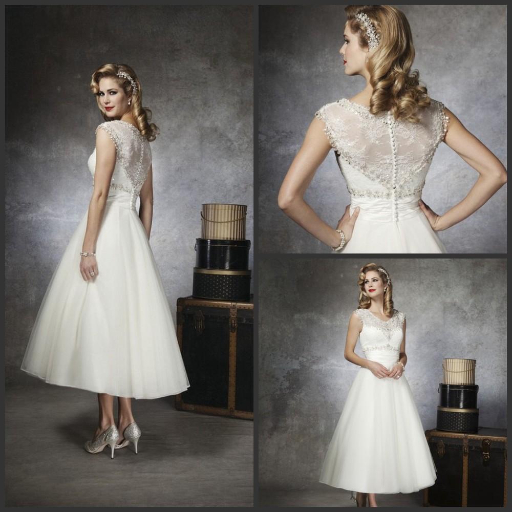 bridal wear t length wedding dresses hn abigail Strapless satin tea length wedding gown