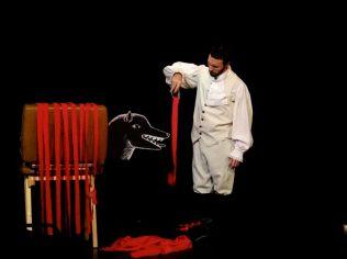 Derek Lee Miller in Marie Jeanne Valet, Who Defeated La Bete du Gevaudan for Sandbox Theatre's Suitcase (2013)