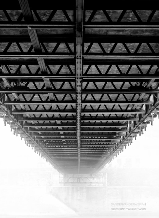 Under an old bridge in Lyon during a foggy, autumn morning.