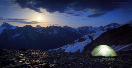 Campsite with the moon rising above the Matterhorn in Wallis, Switzerland.