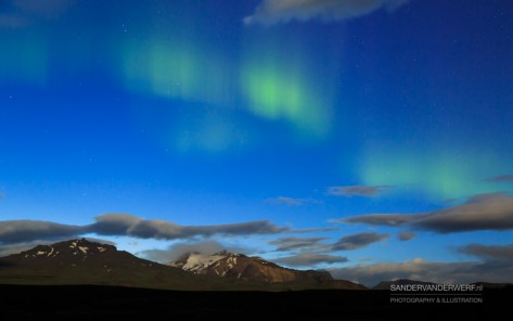 Aurora borealis over the mountains near Porsmork.