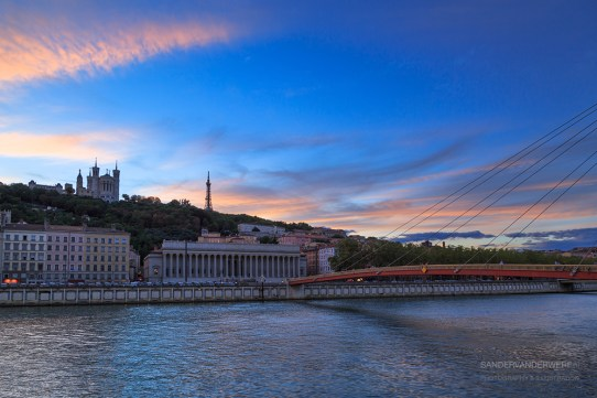 Colorful sunset over the Saone river and the Basilique Notre-Dame de Fourviere.