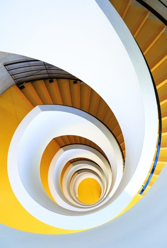 Unique yellow spiral staircase at Bibliothèque Universitaire de Chevreul.