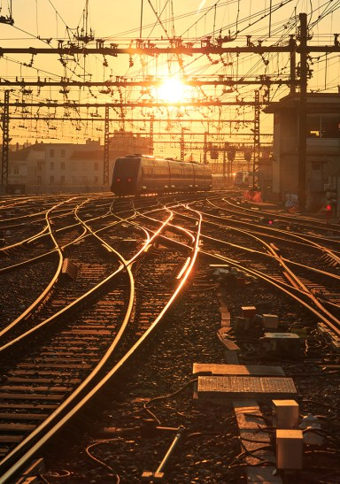 Sunrise over the railroad tracks at Perrache station in Lyon, France.