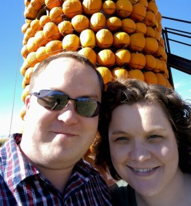 This is a silo with pumpkins attached all the way around and all the way to the top!