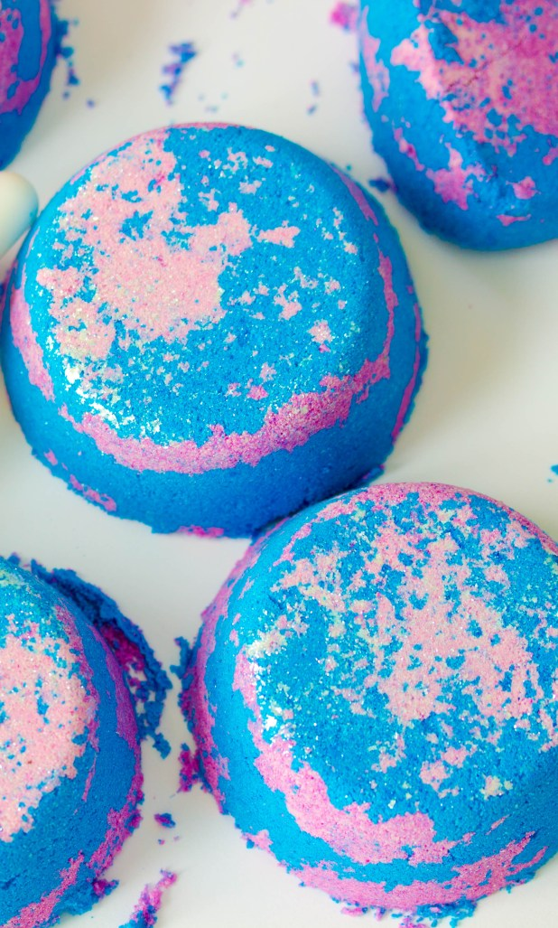 Groovy blueberry lush style bath bombs that will not only sparkle your tub, but will moisturize your skin and make you smell like a wonderful blend of patchouli and blueberries!