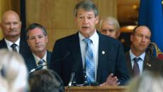 "North Dakota Attorney General Wayne Stenehjem, center, announces on 6-29-2015 at the state Capitol in Bismarck, the state joining attorneys general from 11 other states in a lawsuit against the Environmental Protection Agency and the U.S. Army Corps of Engineers over the EPA's new rule defining ""Waters of the United States"" under the Clean Water Act. Second from the left is North Dakota Agriculture Commissioner Doug Goehring. 6-29-2015"