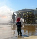 boy watching firemen