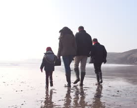 Walking on a cold beach http://www.destinationsdreamsanddogs.com/wp-content/uploads/2014/12/stock-footage-multi-generation-family-walking-on-winter-beach-with-dog.jpg