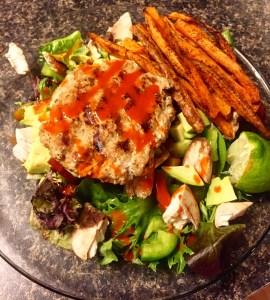 Homemade Turkey Burger on a bed of mixed greens and advocado. Mmmm.