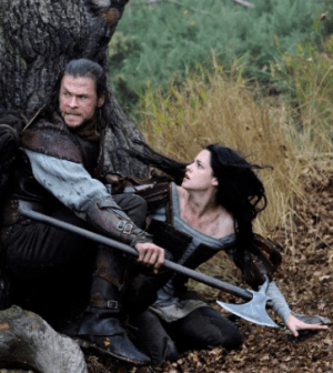 Chris Hemsworth and Kristen Stewart in Snow White and the Huntsman.  © 2012 - Universal Pictures.