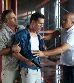 Bruce Campbell as Sam Axe, Jeffrey Donovan as Michael Westen, Coby Bell as Jesse Porter. Photo by Glenn Watson/USA