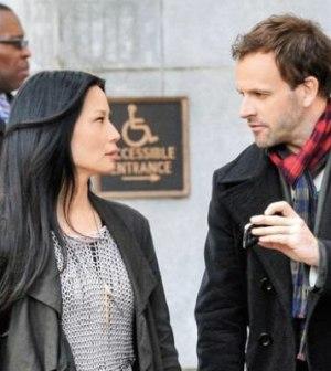 (L) Lucy Liu as Joan Watson. (R) Jonny Lee Miller as Sherlock Holmes. Image © CBS Television Network.