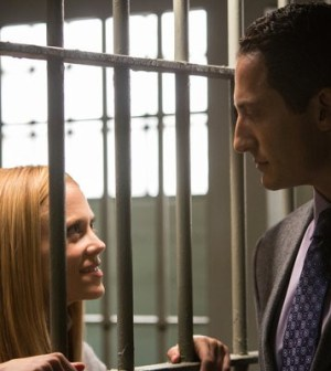 Claire Coffee and Sasha Roiz in Grimm. Image © NBC