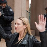 Olivia (Anna Torv, C) surrenders to the alternate universe Fringe Division (Photo by Liane Hentscher/FOX)