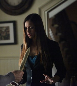 Elena and Jeremy find themselves in a tight spot. Image © The CW