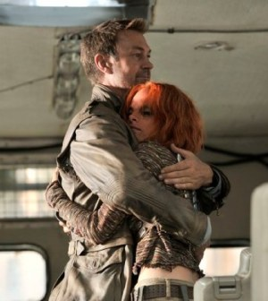 Grant Bowler and Stephanie Leonidas in Defiance. Image © Syfy