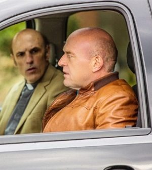 """Pictured: Dean Norris as James """"Big Jim"""" Rennie and Ned Bellamy as Rev. Lester Coggins Photo: Michael Tackett/©2013 CBS Broadcasting Inc.."""