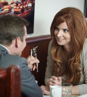 Pictured: Gabriel Macht as Harvey, Sarah Rafferty as Donna. (Photo by: Ian Watson/USA Network)