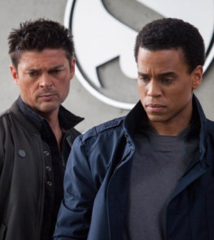 Det. John Kennex (Karl Urban, L) and Dorian (Michael Ealy, R) in Almost Human. Co. Cr: Liane Hentscher/FOX