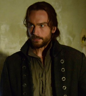 "Ichabod Crane (Tom Mison) searches a colonial-era house which holds secrets in Slepy Hollow's ""Sanctuary"" Episode. Co. CR: Brownie Harris/FOX"